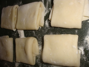 Roti dough folded after the first roll