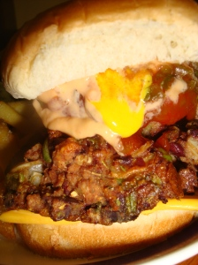 Spicy bean burger... with cheese, onion, pineapple and every condiment known to mankind and a few more besides...