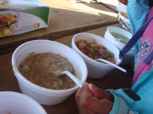 One tiny girl, three huge bowls of soup!