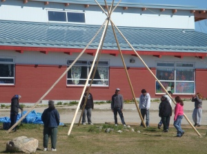 First lie the three main poles on the ground, tie them securely, then raise to form the basis of the tipi.